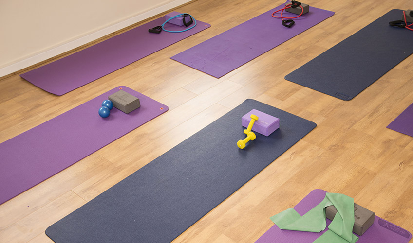 Floor mats and exercise equipment at the Elite Fitness studio